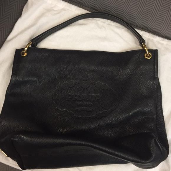 ef97101a6ae2 Prada Vitello Daino single strap hobo bag. M 5bb54979c89e1da9481c1f5f